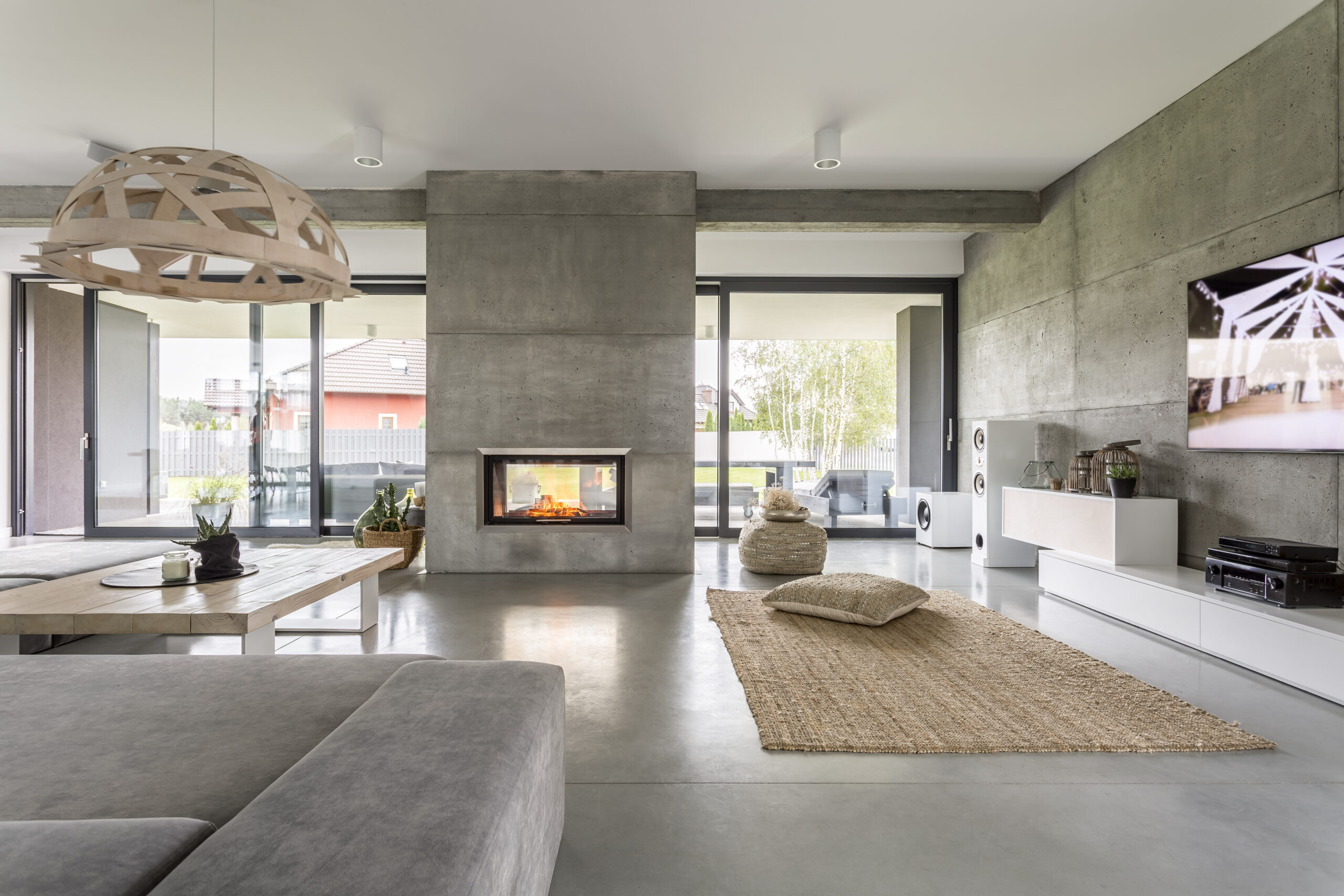 alt-Spacious,villa,interior,with,cement,wall,effect,,fireplace,and,tv